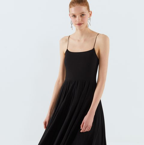 Clothing, Dress, Black, Cocktail dress, Day dress, Fashion model, Little black dress, Shoulder, A-line, Waist,