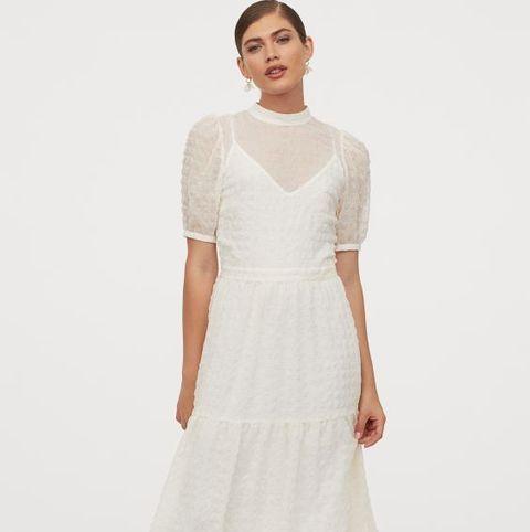 Clothing, White, Dress, Fashion model, Day dress, Fashion, Sleeve, Gown, Shoulder, Neck,