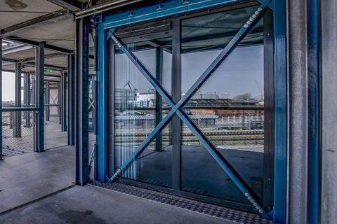 Blue, Iron, Architecture, Metal, Urban area, Door, Building, City, Glass, Steel,
