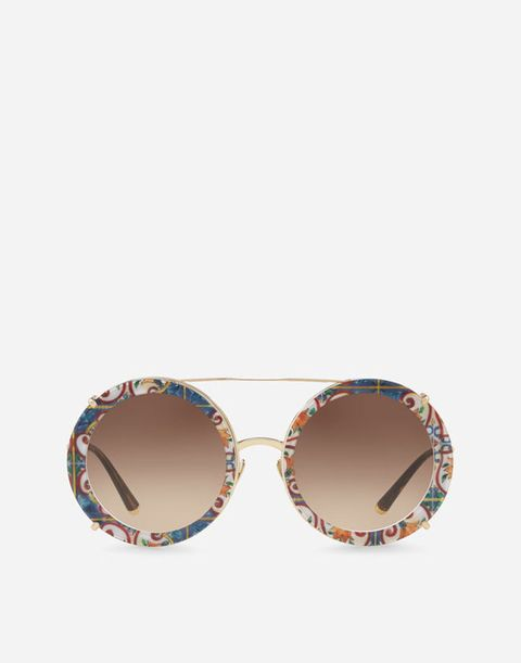 Eyewear, Sunglasses, Glasses, Personal protective equipment, aviator sunglass, Brown, Vision care, Goggles, Beige, Fashion accessory,