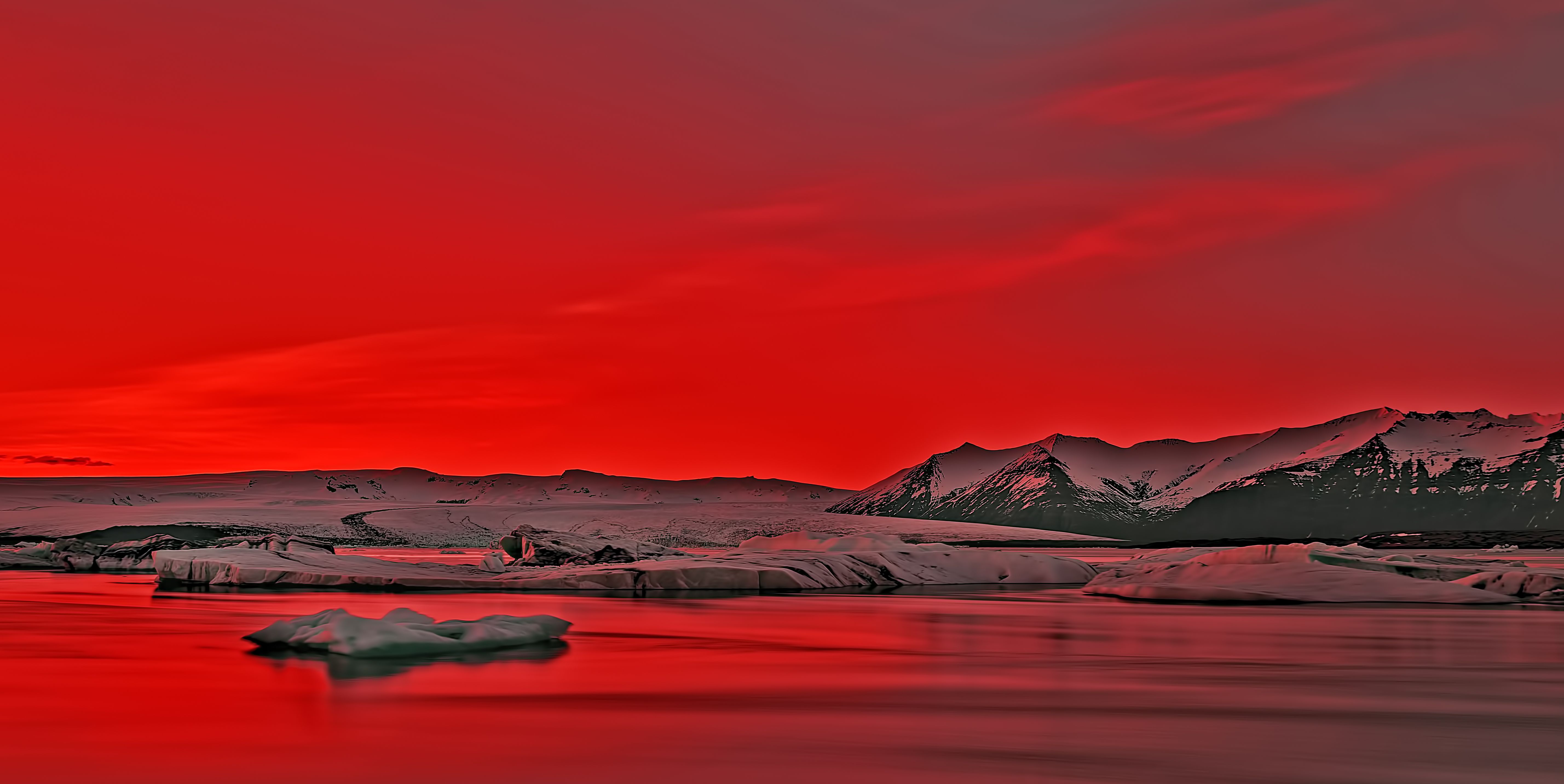 Vibrant Red Sunset Over Icebergs in Jokulsarlon Glacier Lagoon, Iceland