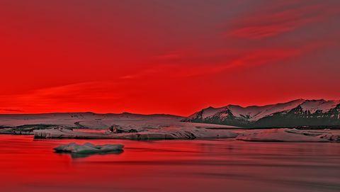 Vibrant Red Sunset Over Icebergs in Jokulsarlon Glacier Lagoon, Iceland