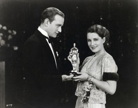 Conrad Nagel Presents Oscar to Norma Shearer