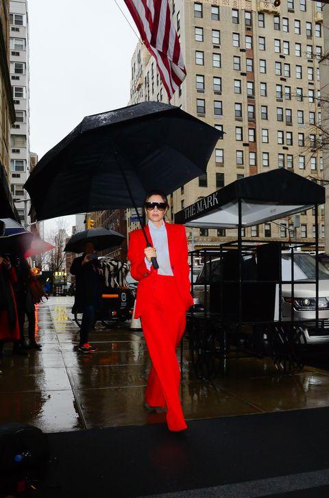 Umbrella, Red, Fashion accessory, Architecture, Event, City, Rain, Street,
