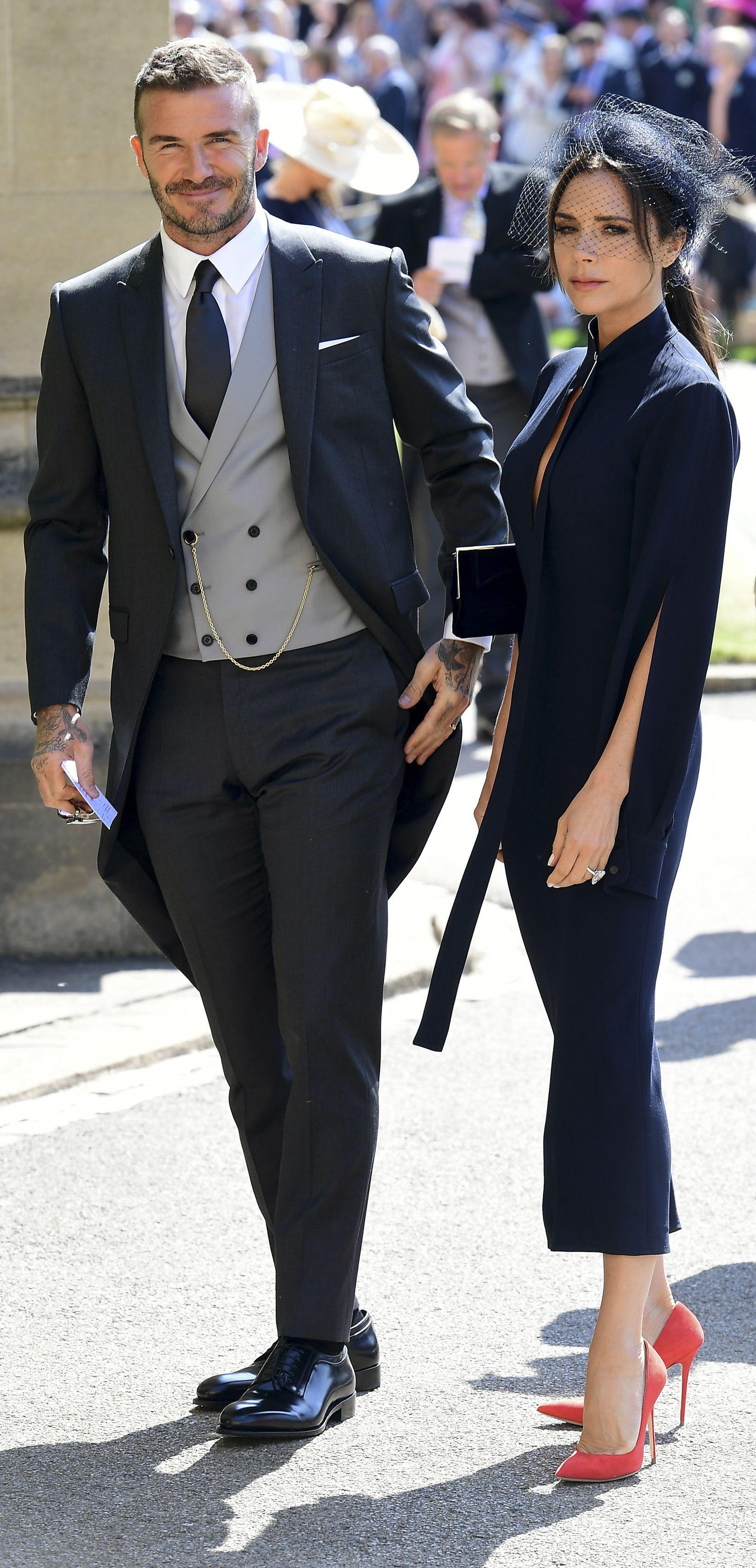 https://hips.hearstapps.com/hmg-prod.s3.amazonaws.com/images/victoria-beckham-royal-wedding-2018-1526724629.jpg