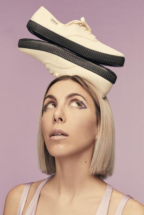 Clothing, Hat, Fashion accessory, Beige, Fashion, Headgear, Lip, Costume hat, Costume accessory, Sun hat,