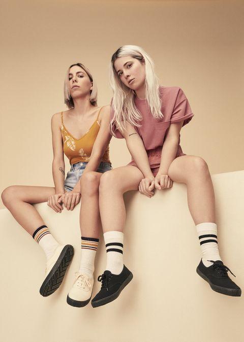 White, Footwear, Human leg, Leg, Skin, Sitting, Beauty, Shoe, Fashion, Blond,