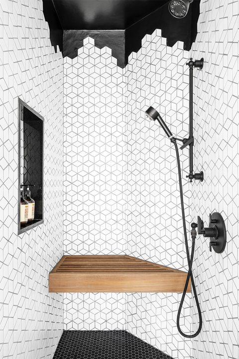living the clean dream 1920 victorian home in houston, texas designer maureen stevens, maureenstevenscom bathroom, asymmetrical shower with black and white tiles