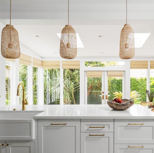 living the clean dream 1920 victorian home in houston, texas designer maureen stevens, maureenstevenscom kitchen island, open weave lighting