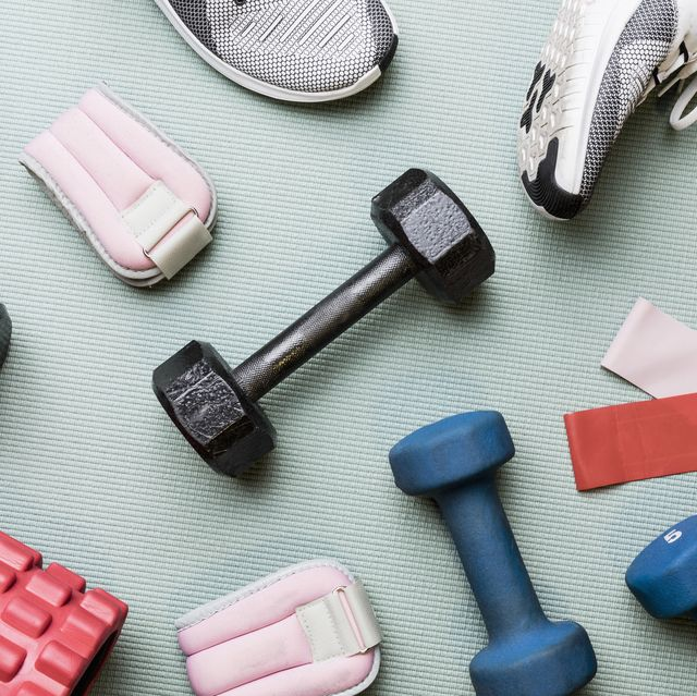 view from above dumbbells and exercise equipment   knolling