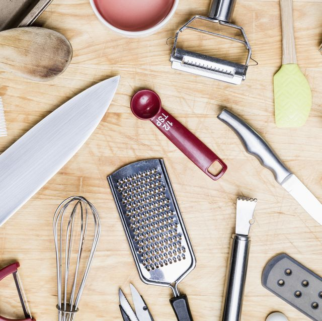 view from above kitchen utensils on wooden surface   knolling
