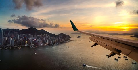 View from airplane window. Flying over Hong Kong city