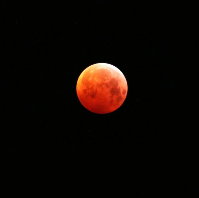 view of blood moon against sky at night