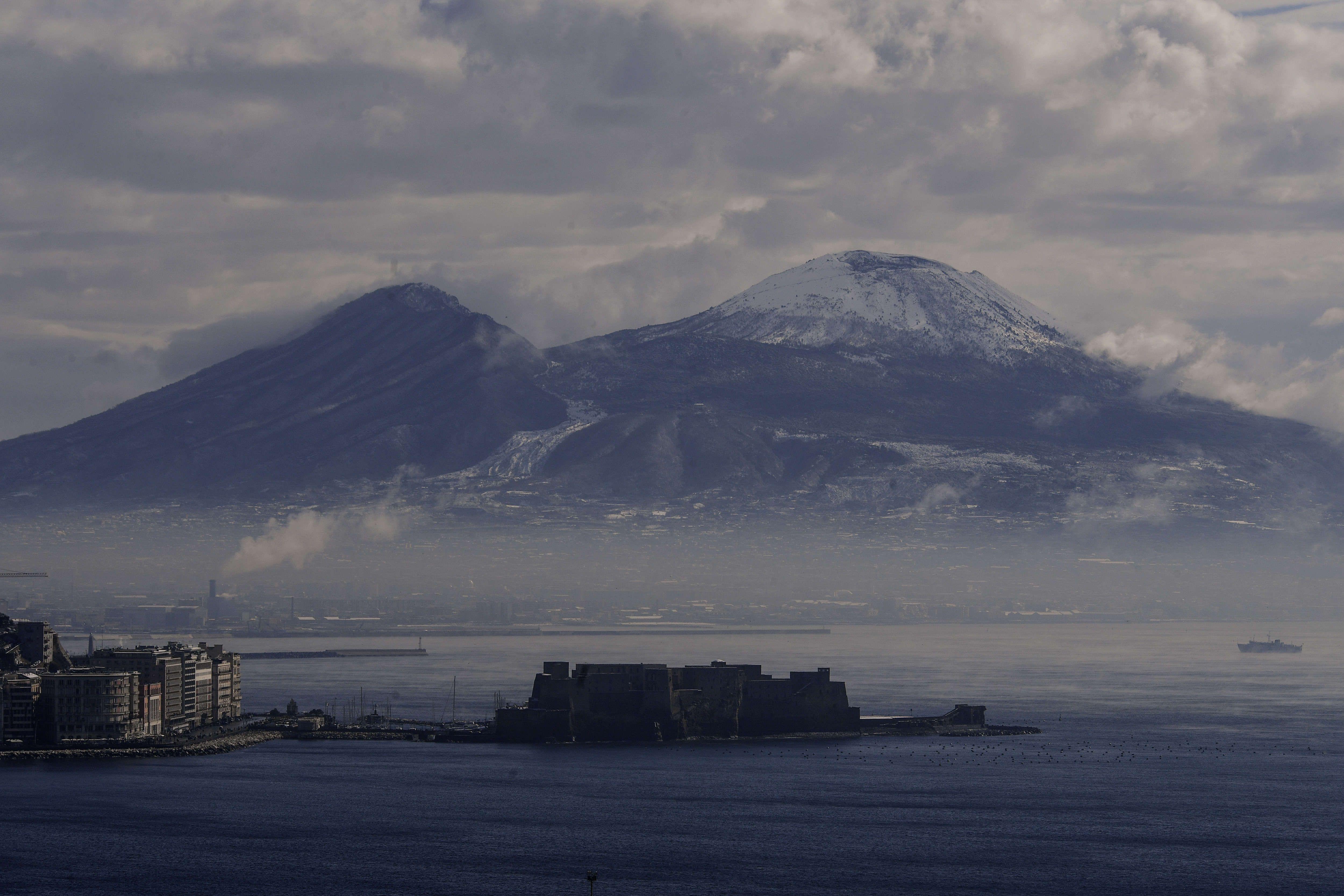 A view of Castello dell' ovo (Egg Castle) and Vesuvius...