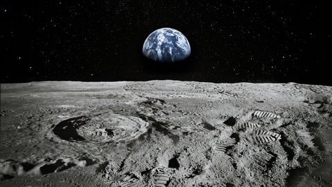 view of moon limb with earth rising on the horizon footprints as an evidence of people being there or great forgery collage elements of this image furnished by nasa