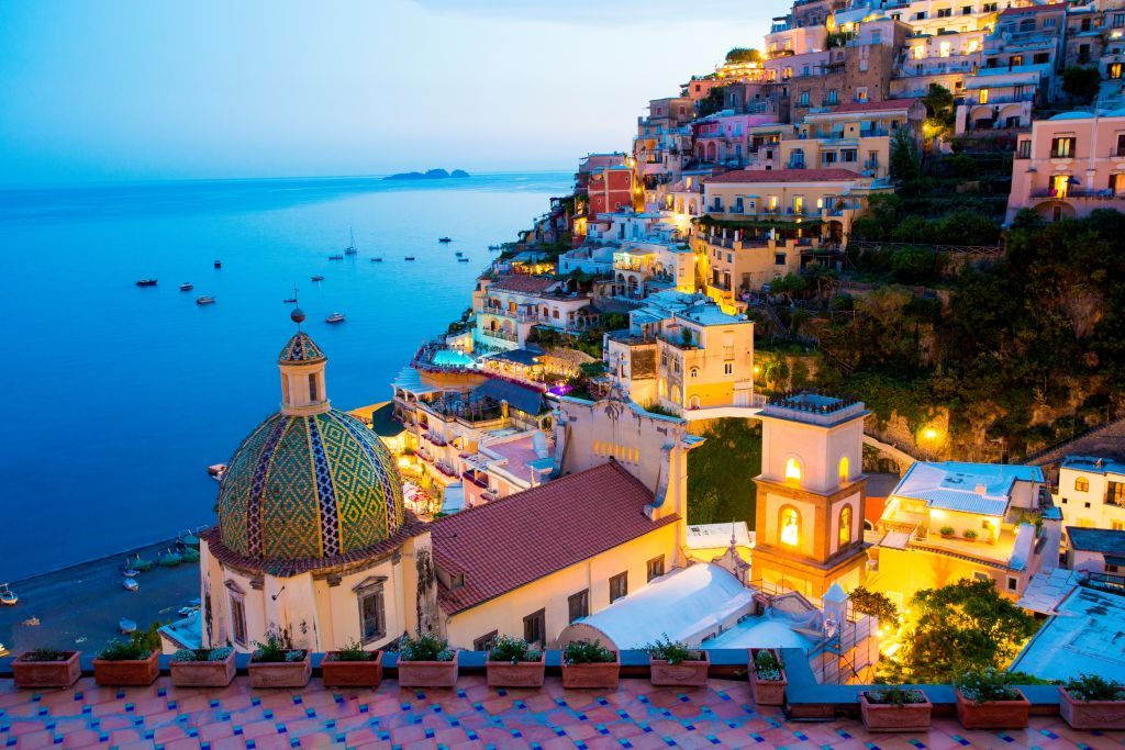 View of the town and the seaside in a summer sunset. Positano. Amalfi Coast. Campania. Italy