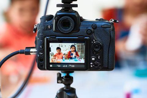 View through video camera towards children making slime