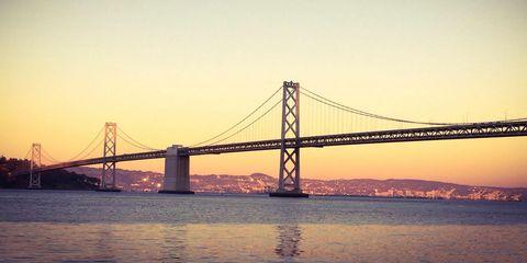 Bridge, Suspension bridge, Water, Horizon, Waterway, Dusk, Landmark, Fixed link, Evening, Cable-stayed bridge,