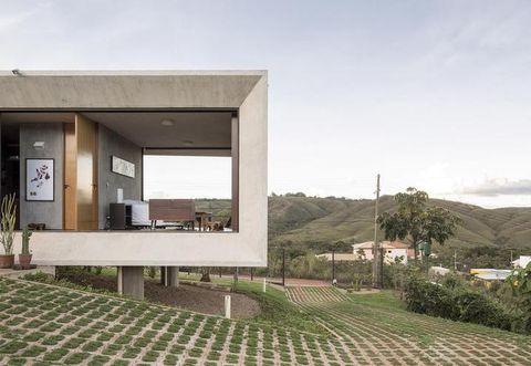 Property, Real estate, Land lot, Concrete, Composite material, Shade, Urban design, Flowerpot, Cobblestone, Landscaping,