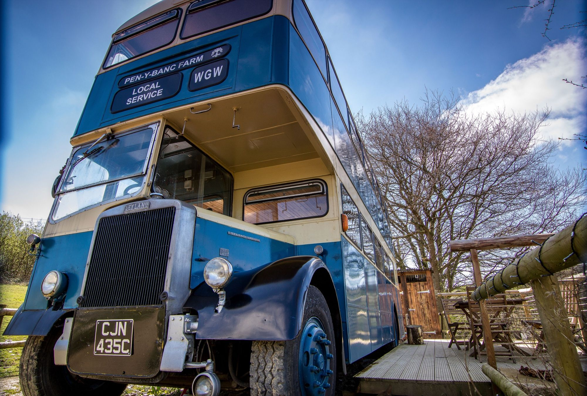 Stay in a converted vintage double-decker bus in the Welsh countryside