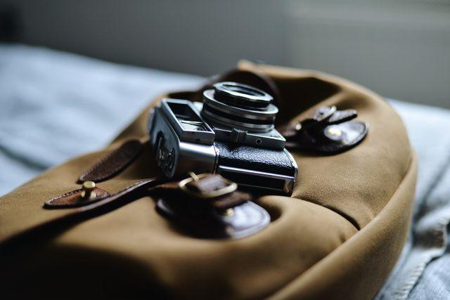 vintage film camera and bag
