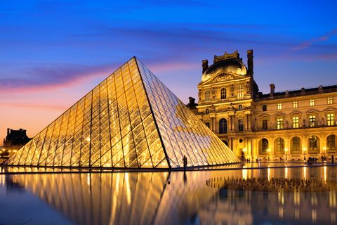 the louvre museum illuminated glass pyramid entrance