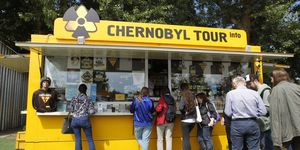 Visitors seen stand next to a shop with Chernobyl souvenirs...
