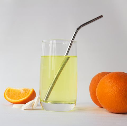 vitamin c soluble effervescent tablets in a glass of water with a stainless straw orange he drink enhances immunity and resistance to viruses