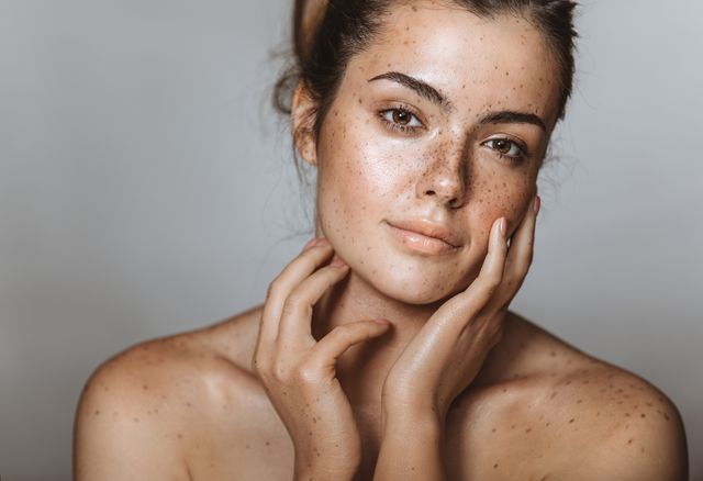 beautiful young girl with freckle studio shot