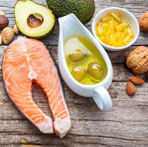 selection food sources of omega 3 and unsaturated fats superfood high vitamin e and dietary fiber for healthy food almond,pecan,hazelnuts,walnuts,olive oil,fish oil and salmon on wooden background