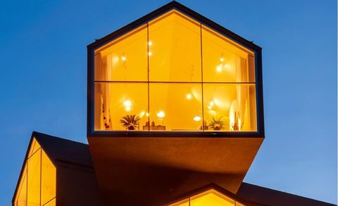 Lighting, House, Home, Yellow, Architecture, Facade, Building, Light fixture, Window, Lighting accessory,