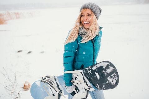 Lachende snowboarder