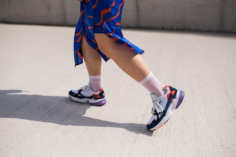 Footwear, Human leg, Blue, Leg, Ankle, Shoe, Inline skates, Joint, Knee, Roller skates,