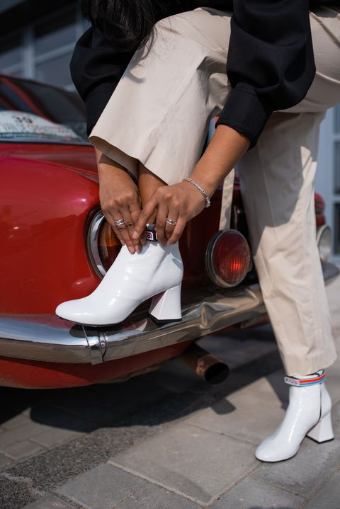 White, Footwear, Red, Shoe, Leg, Vehicle, Car, Automotive design, Human leg, Jeans,