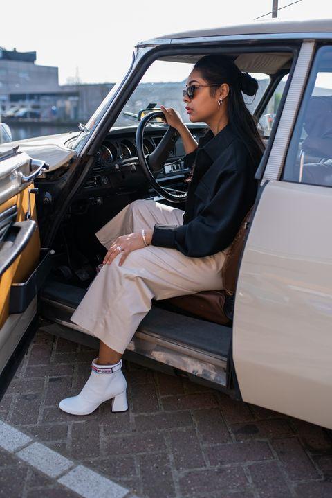 Vehicle, Vehicle door, Car, Luxury vehicle, Snapshot, Automotive design, Fashion, Footwear, Leg, Photography,