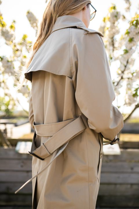 Clothing, Trench coat, Coat, Shoulder, Outerwear, Street fashion, Joint, Fashion, Beige, Sleeve,