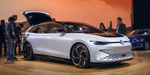 Land vehicle, Vehicle, Car, Auto show, Automotive design, Mid-size car, Sky, Hatchback, Personal luxury car, Full-size car,