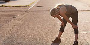 Runner bent over dry heaving