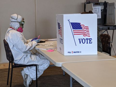 elections chief inspector mary magdalen moser runs a polling location in kenosha, wisconsin, in full hazmat gear as the wisconsin primary kicks off despite the coronavirus pandemics on april 7, 2020   voters in wisconsin began casting ballots tuesday in a controversial presidential primary held despite a state wide, stay at home order and concern that the election could expose thousands of voters and poll workers to the coronavirus democratic officials had sought to postpone the election but were overruled by the top state court, and the us supreme court stepped in to bar an extension of voting by mail that would have allowed more people to cast ballots without going to polling stations both courts have conservative majorities photo by derek r henkle  afp photo by derek r henkleafp via getty images