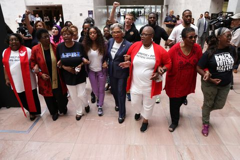 activists protest against state-level Republicans trying to pass restrictive voting laws