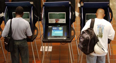 An electronic voting machine sits idle a