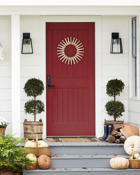 shaker peg wreath on a maroon door