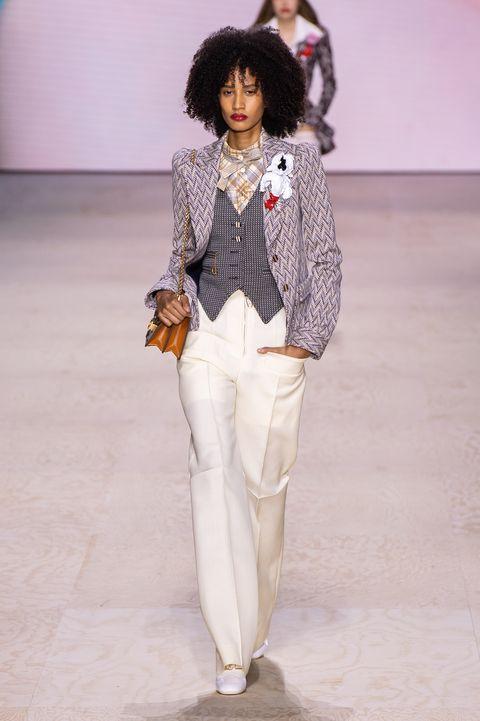 White, Fashion, Clothing, Fashion show, Fashion model, Runway, Pantsuit, Human, Fashion design, Joint,