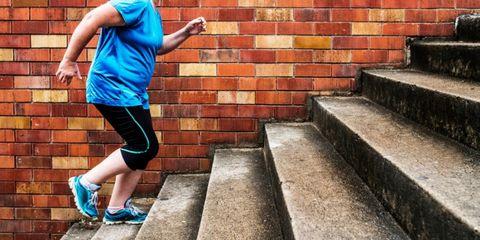 Leg, Human leg, Human body, Shoe, Wall, Brick, Elbow, Shorts, Knee, Active shorts,