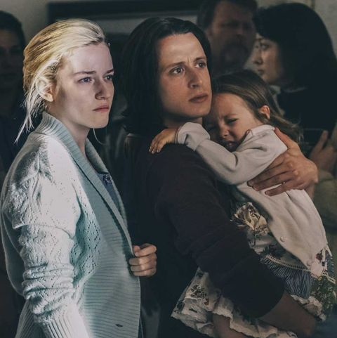 julia garner and rory culkin in waco culkin is holding a young girl