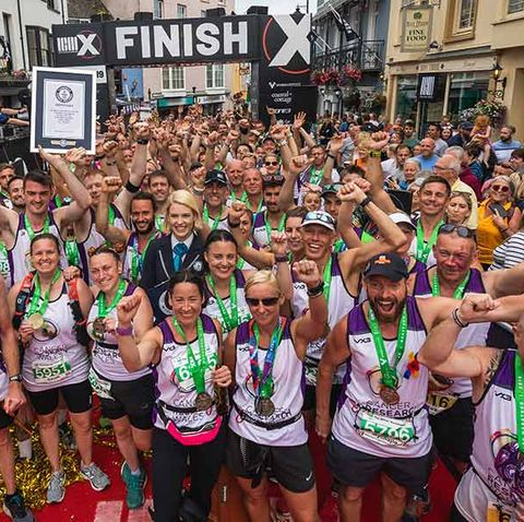 122 runners run marathon tied together to raise money for Cancer Research Wales