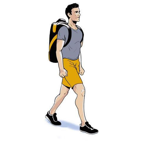 man walking with weight on his back