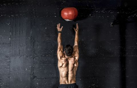 Physical fitness, Standing, Arm, Muscle, Exercise equipment, Ball, Crossfit, Sports equipment, Stock photography, Chest,