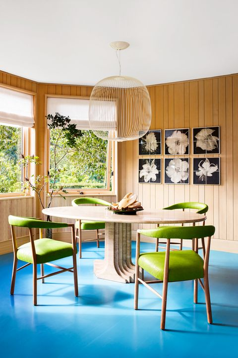dining room with wood paneled walls