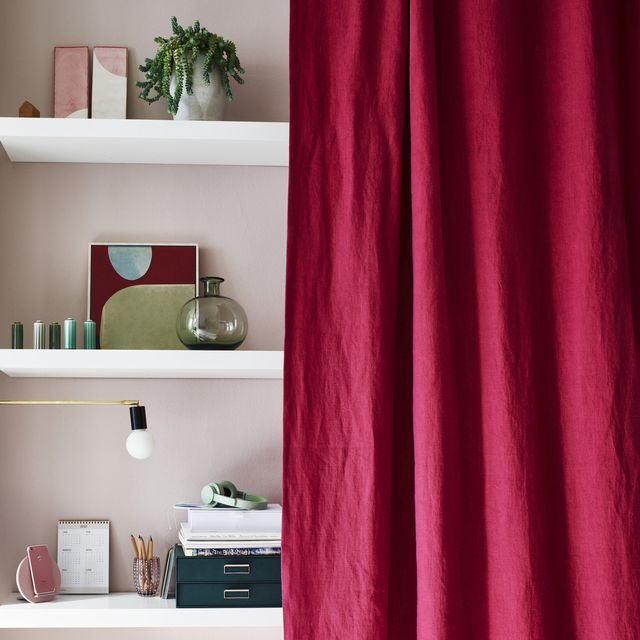 floating wall shelves covered with a pink linen curtain
